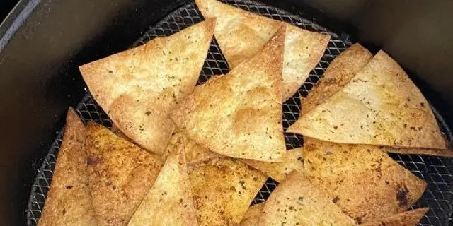These air fryer tortilla chips only require olive oil and Cajun seasoning.