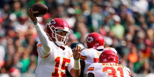 Kansas City Chiefs quarterback Patrick Mahomes (15) looks to pass during the first half of an NFL football game against the Philadelphia Eagles on Sunday, Oct. 3, 2021, in Philadelphia.