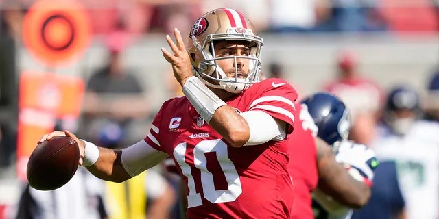 San Francisco 49ers quarterback Jimmy Garoppolo (10) passes against the Seattle Seahawks during the first half of an NFL football game in Santa Clara, Calif., Sunday, Oct. 3, 2021.