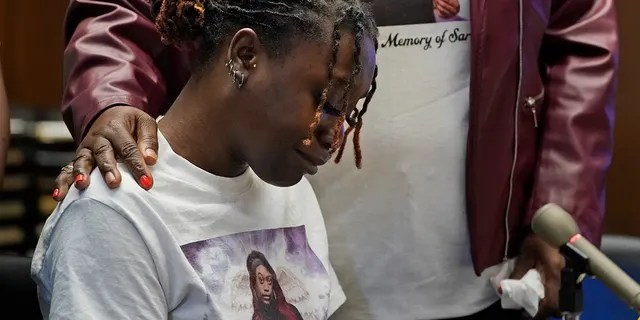 Aliyah, left, and Laverne Butler, sister and mother of Sarah Butler, wear shirts with Sarah Butler's picture as they give victim impact statements during the sentencing for Khalil Wheeler-Weaver in Newark, N.J., Wednesday, Oct. 6, 2021. Wheeler-Weaver, a New Jersey man who used dating apps to lure three women, including Robin West, to their deaths and attempted to kill a fourth woman five years ago, was sentenced to 160 years in prison on Wednesday, as he defiantly proclaimed his innocence. (AP Photo/Seth Wenig, Pool)