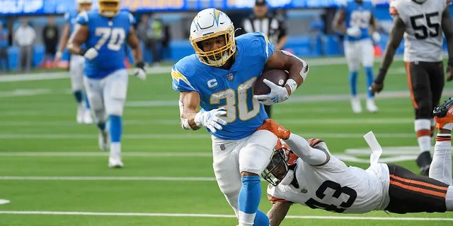 Los Angeles Chargers running back Austin Ekeler scores a touchdown past Cleveland Browns free safety John Johnson (43) during the second half Sunday.