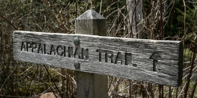 A trail sign at Clingmans Dome, a major scenic viewing point along the Appalachian Trail, on May 11, 2018, near Cherokee, North Carolina. The Great Smoky Mountains National Park straddles the Tennessee and North Carolina borders in the heart of the Appalachian Mountain Range.