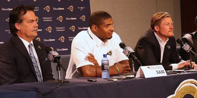 EARTH CITY, MO - MAY 13: (L to R) St. Louis Rams head coach Jeff Fischer, draft pick Michael Sam and general manager Les Snead address the media during a press conference at Rams Park on May 13, 2014 in Earth City, Missouri. (Photo by Dilip Vishwanat/Getty Images)