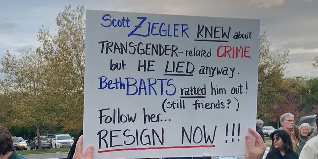 A protester holds up a sign in Loudoun County, Virginia.