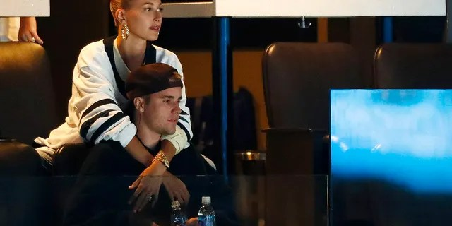 Justin Bieber and wife, Hailey Rhode Bieber, watch Game Seven of the Eastern Conference First Round during the 2019 NHL Stanley Cup Playoffs between the Boston Bruins and the Toronto Maple Leafs at TD Garden on April 23, 2019, in Boston, Massachusetts.