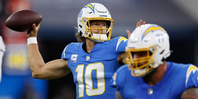 Quarterback Justin Herbert #10 of the Los Angeles Chargers passes against the Las Vegas Raiders during the first half at SoFi Stadium on October 4, 2021 in Inglewood, California.