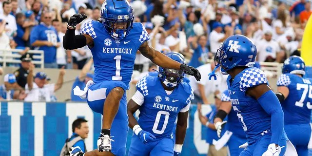 Kentucky wide receiver Wan'Dale Robinson (1) celebrates after scoring a touchdown during the first half of an NCAA college football game against Florida in Lexington, Ky., Saturday, Oct. 2, 2021.