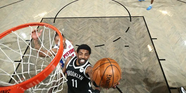 Kyrie Irving #11 of the Brooklyn Nets shoots the ball during the game against the Detroit Pistons on March 13, 2021, at Barclays Center in Brooklyn, New York.