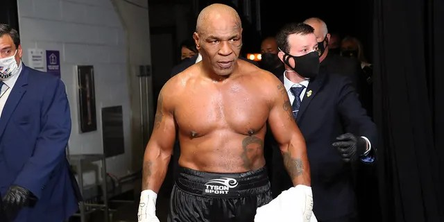 Mike Tyson exits the ring after receiving a split draw against Roy Jones Jr. during Mike Tyson vs Roy Jones Jr. presented by Triller at Staples Center on Nov. 28, 2020, in Los Angeles, California.