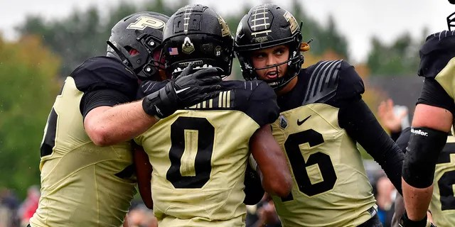 Purdue Boilermakers wide receiver Milton Wright (0) shares a moment with quarterback Aidan O'Connell (16) after a touchdown pass during the second quarter against the Minnesota Golden Gophers at Ross-Ade Stadium Oct 2, 2021.