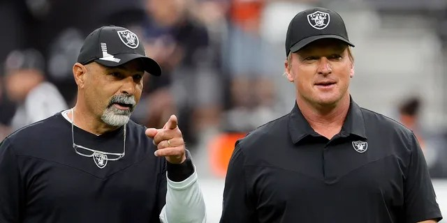 LAS VEGAS, NEVADA - OCTOBER 10: Assistant head coach/special teams coordinator Rich Bisaccia (L) and head coach Jon Gruden of the Las Vegas Raiders talk on the field before their game against the Chicago Bears at Allegiant Stadium on October 10, 2021 in Las Vegas, Nevada. The Bears defeated the Raiders 20-9.