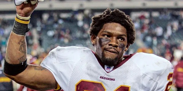 Washington Redskins safety Sean Taylor raises his hand to acknowledge fans after the Redskins defeated the Philadelphia Eagles in Philadelphia in this January 1, 2006 file photograph. Taylor, who was shot and killed at his Florida residence on November 26, 2007, was elected as a starting player to the NFL Pro Bowl posthumously on Dec. 18, 2007.