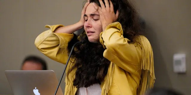 Hannah Kaye paused to recompose herself before giving a victim impact statement during John T. Earnest's sentencing hearing in Superior Court, Thursday, Sept. 30, 2021, in San Diego. (Nelvin C. Cepeda/The San Diego Union-Tribune via AP)