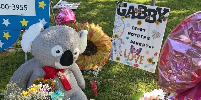 A memorial for Gabby Petito grows near City Hall in North Port, Florida with heartfelt messages left in her memory.