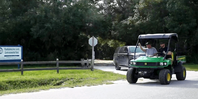 Christopher Laundrie is seen being escorted by law enforcement at the Myakkahatchee Creek Environmental Park. (Fox News)