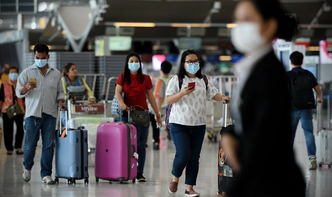With masks at the airport