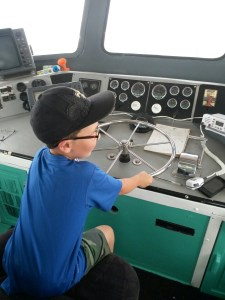orange beach party boat fishing child at the wheel