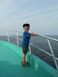 child enjoying affordable family deep sea fishing gulf shores al