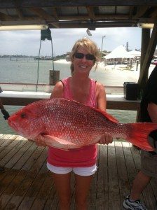deep sea fishing Orange Beach AL lady angler and a tasty red snapper