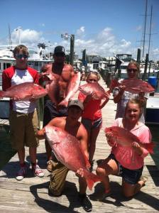 Crew of Texas Anglers displaying their red snapper catch bottom fishing with Captain Salley