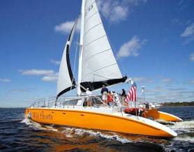gulf shores al sailing full sail in back waters of the AL Gulf Coast