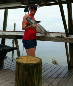 lady texas angler with her king mackerel caught deep sea fishing off the AL gulf of mexico beaches