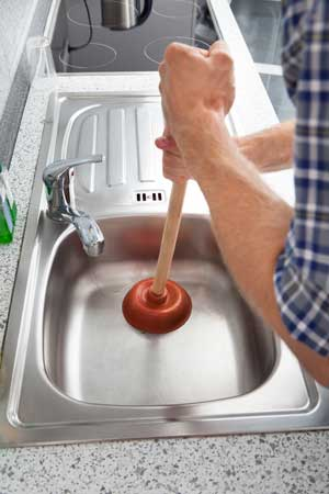 clogged kitchen sink again really