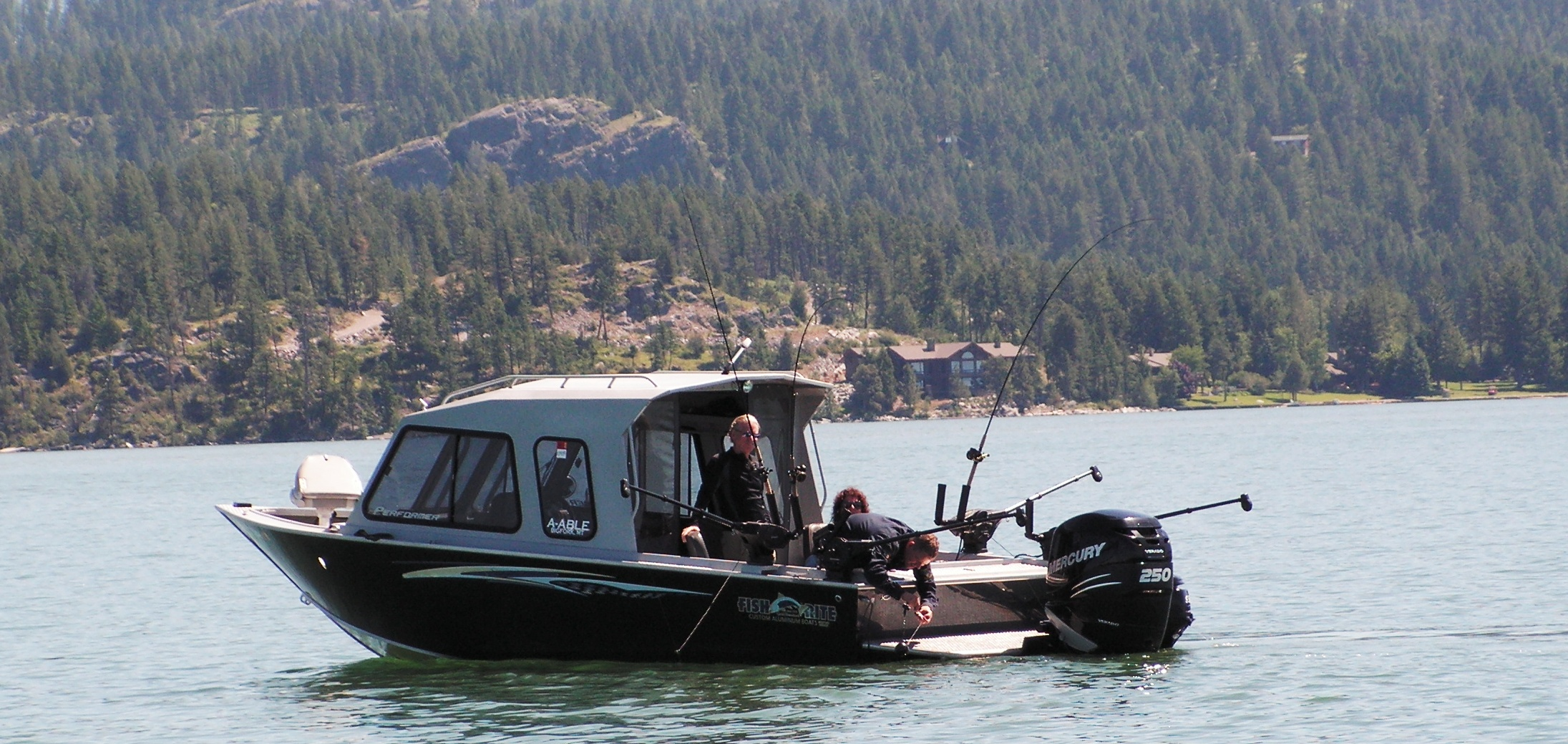 The finest fishing boat fleet in northwest montana howe for Lake fishing boats