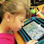 child with AAC device