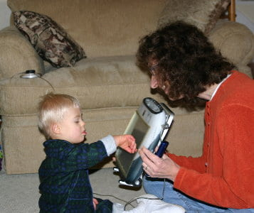 young child with AAC device
