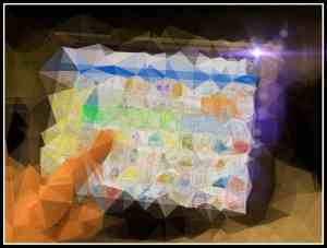 Image of a hand touching an AAC app, seen through a prism.