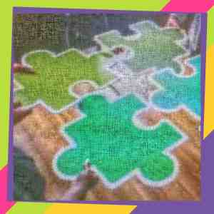 Image of hands putting together large puzzle pieces