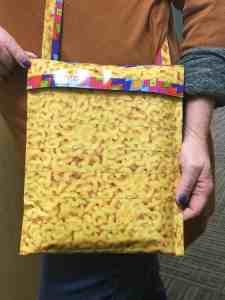 Image of an iPad carrying case made from macaroni and cheese duct tape.