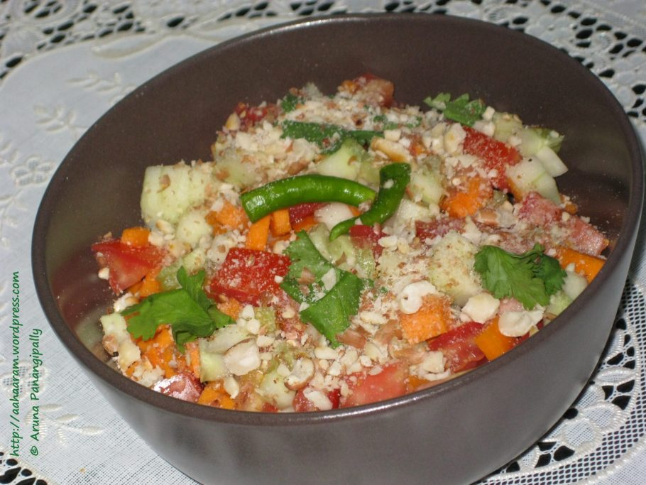Koshambir is a simple fresh salad that has carrots, cucumber, and tomato