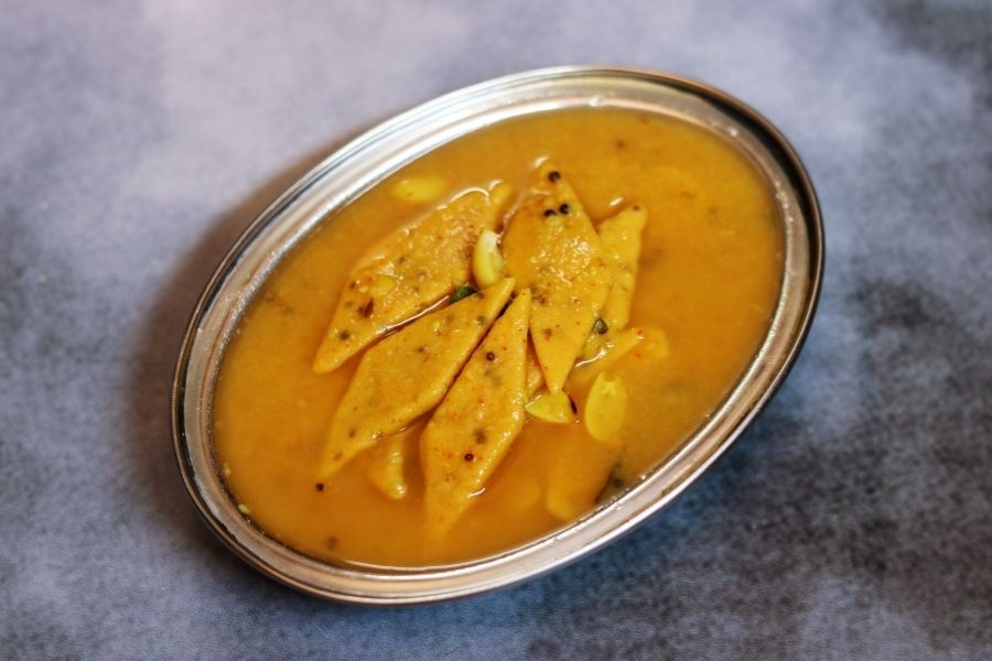 Dal Dhokli : Spiced wheat flour slices cooked in a thin, sweet, tangy dal.