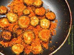 Kakarakaya Endu Kobbari Kharam is an Andhra recipe of fried bitter gourd flavoured with dried coconut, garlic and red chilli powder.
