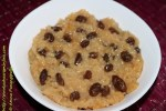 Vegan Rice Pudding Cooked in Coconut Milk, Flavoured with Cinnamon, Garnished with Raisins