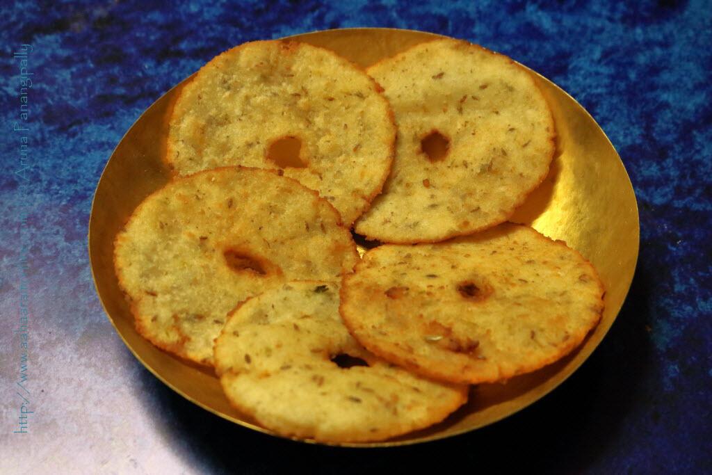 Andhra Kobbari Garelu served on a brass plate