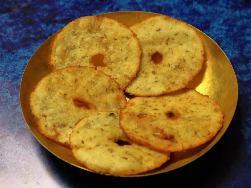 Andhra Kobbari Garelu served on a brass plate