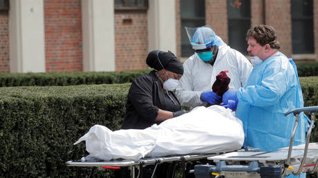 FILE PHOTO: Healthcare workers prepare to transfer the body of a deceased person at a Brooklyn hospital during the Covid-19 outbreak in New York.