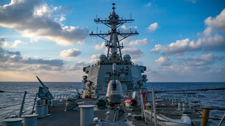 The Arleigh-Burke class guided-missile destroyer USS Barry (DDG 52) conducting underway operations on April 28, 2020 in the South China Sea