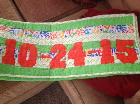 This is a baby blanket we were making when the baby was born. We added the name and birthday with applique.