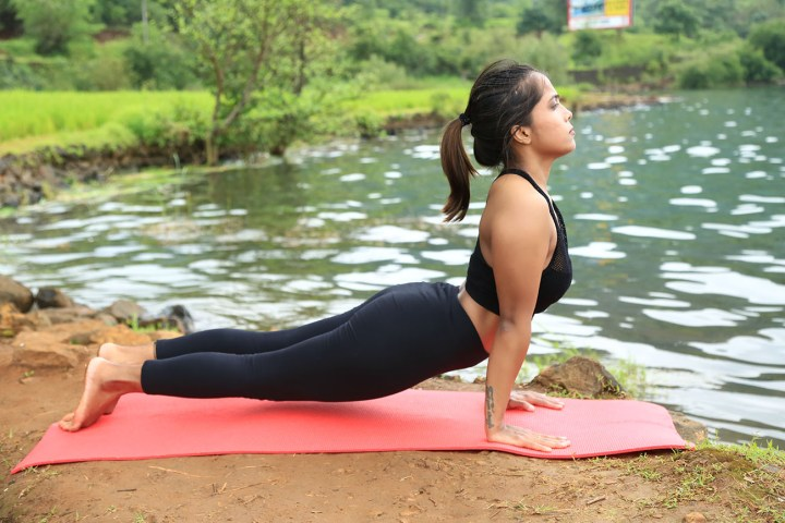a girl performing upward facing dog for a healthy spine
