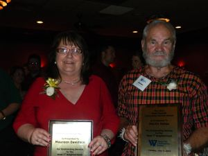 From left, Maureen Davidson, director of Senior Services at West 7th Community Center, and Marlin Heise, co-founder of Hmong Archives, at Mancini's Char House on June 3, where they both received a West 7th Community Service Award. (Photos by Vang T. Xiong)