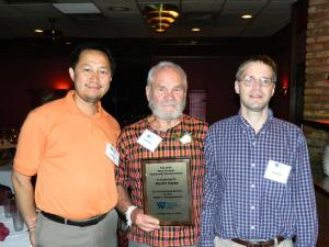 From left, Hmong Archives board member Tou Pao Lor, Marlin Heise, Archivist, and Mark Pfeifer, PhD, Editor, Hmong Studies Journal, celebrate Heise receiving a West 7th Community Service Award on June 3, 2014 at Mancini's Char House in St. Paul. (Photo by Vang T. Xiong)