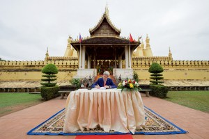 U.S. Secretary of State John Kerry signs the guest book after visiting the That Luang Stupa - the most revered Buddhist temple in Laos - following meetings with government leaders on Jan. 25, 2016, in Vientiane, Laos. [State Department Photo]