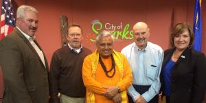 Just before the Hindu invocation, from left, Spark City Councilmembers Ed Lawson and Ron Smith, Hindu priest Rajan Zed, Sparks City Mayor Geno Martini, and Councilmember Charlene Bybee.