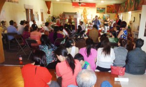 The Laotian community of Warroad talks with Roseau County District 2 Commissioner Jack Swanson at the Warroad Buddhist temple on July 1. (Photo by Jay Clark)