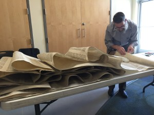 Rabbi Druin unfurls the whole torah to begin work. Photo by Dave Nelson