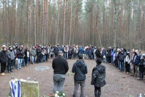 Students leading a memorial ceremony for their peers at Łopuchowo, the site of a Nazi massacre of Polish Jews